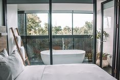 """Tucked away in a corner in Double Six Seminyak, Lloyd's Inn Bali isa hidden oasis of architecture and nature."" The hotel's very stylish, modern and clean. The Beach, Oasis, Architecture, Modern, Nature, Indonesia, Arquitetura, Trendy Tree, Naturaleza"
