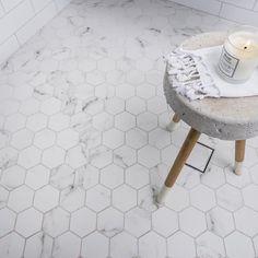 Hexagonal Carrara tiles @amberkellyville @ambertiles #sevenweekreno #realrenos | candle and Turkish towel by @livedincoogee