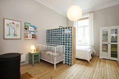 So not strictly a nursery, but a cleverly combined ma and pa/ baby room. So simply and confidently executed, with old and new elements. That gorgeous (Ferm Living, I think) wallpaper adds such personality. Great inspiration for those wishing to room share with the little un...