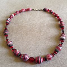 #necklace #pieces made with #upcycled #paper #resin #magazine #recycled #material #craft #red #glass #beads #jewelry #handmade #designed  by Mari M.