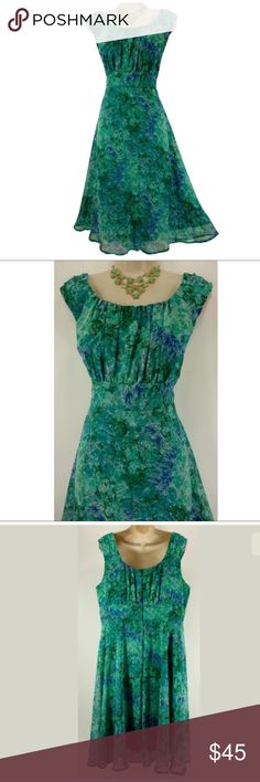 """16W 1X WATERCOLOR FLORAL CHIFFON DRESS Plus Size This gorgeous watercolor floral piece is sexy, sweet, and fashionable!   Size: 16W Back zip Ruched bust Flowy, chiffon fabric Beautiful watercolor floral print in shades of blue & green Fully lined Measurements: Bust (armpit to armpit):  50"""" Waist: 41"""" Hips:  63""""  Length: 43.5"""" (top of shoulder to bottom hem)  Condition:  PRISTINE CONDITION! Fabric Content: 100% Polyester  Fabric Care:  Machine Wash Dress Barn Dresses Midi"""