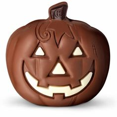 Hotel Chocolat's chocolate pumpkin, the Yumpkin 40% milk chocolate, decorated with white and dark chocolate and presented in a gift bag.