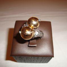 Anello argento brunito e sfere in oro