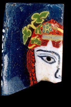 Mask of Maenad, inlay fragment century century CE EGYPT, (Alexandria) Medium: glass Measurements: × × cm Place/s of Execution: Egypt Accession Number: Mosaic Glass, Glass Art, Italy Culture, Dragon Princess, Queen Nefertiti, Classical Antiquity, 1st Century, Greek Art, Ancient Egypt