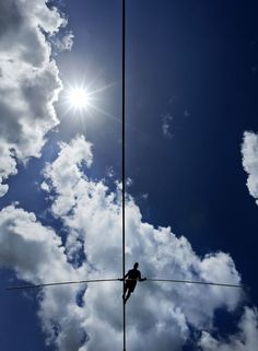 Stunning Images From Around The World - High wire performer Nik Wallenda walks across a wire as he practices Tuesday, June 18, 2013 in Sarasota, Fla. Wallenda, a seventh generation high-wire walker, will attempt to walk across the Grand Canyon on Sunday, June 23, 2013. (AP Photo/Chris O'Meara)