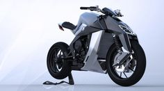 Swiss designer Yacouba Galle is launching the Feline One, an 801cc, 3-cylinder, 170 horsepower bespoke streetfighter that uses exotic materials and a very strange looking twin-shock anti-dive fron...