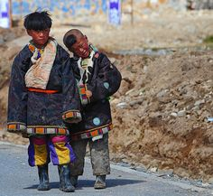 "Tibetan children in chuba ""Tibetan national garb""   by reurinkjan"