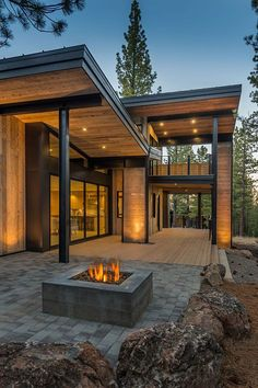 Modern mountain home exterior mountain retreat blends rustic modern styling in camp legacy house modern rustic Modern Patio, Modern Exterior, Exterior Design, Exterior Siding, Rustic Exterior, Modern Decor, Brick Design, Modern Fence, Modern Landscaping