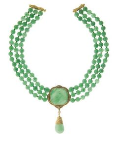 A JADE BEAD AND GOLD NECKLACE, BY CARVIN FRENCH   Designed as three strands of jade beads, measuring approximately 9.00 mm, joined by a jade plaque within a gold foliate surround, suspending a jade and pearl drop, mounted in 18k gold, 15½ ins.