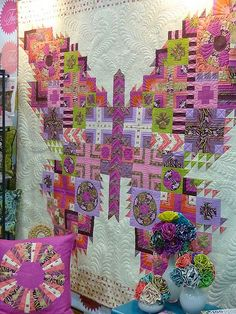 This quilt, by Tula Pink, was spotted at Spring Market. I love the idea, a sampler put into a larger design. I made a few in EQ7.One of the things i