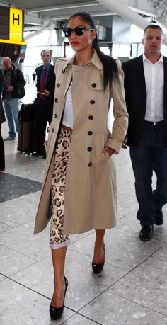 Nicole Scherzinger in leopard trousers and trench coat..