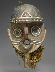 Africa | Nuna/Gurunsi Mask, Burkina Faso| Carved wood with pigment and woven fiber cordage