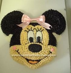 Homemade Minnie Mouse Cake: This Minnie Mouse cake was made for a first birthday party for one of my sister's friends. I used the Wilton Mickey Mouse Pan and converted it to a girl