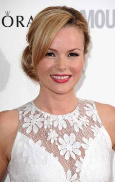 Amanda Holden's bun and bangs combo