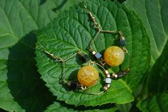 Yellow Fire Agate Chandelier / Dangle Earrings with Hematite & Brass Beads on Gold Wire. $25.00, via Etsy.