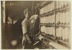 John Dempsey 11 or 12, at Jackson mill, working faithfully in mule spinning room, a dangerous place for boys. No others below 14 were found in this mill. 1909 by Lewis Hine