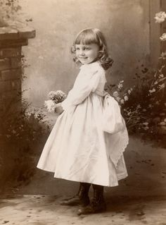 +~+~ Antique Photograph ~+~+  Smiling girl, happy to play in her pretend garden.