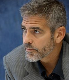 - George Clooney - 2013 - http://www.skincarebeautymag.com/hair-care/hair-styles/trendy-facial-hair-styles-that-give-a-different-look.html