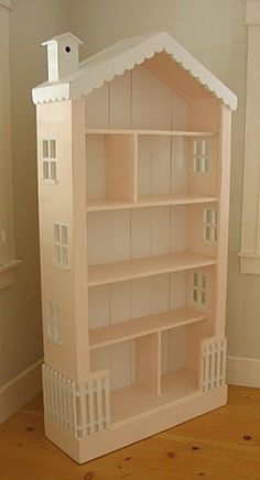 Turn a bookcase into a doll house. Or even use it as a bookcase still and now it's just cuter. Click through for other dollhouses and play kitchens made from old furniture.make a log cabin and use as a bookcase.