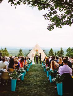 teepee ceremony // flowers, event design and tee pee by Glitter + Rye // chairs from vintage sources and Rent Patina // photo by Pat Furey Photography
