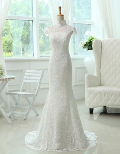 This Stylish Column Style Mandarin Collar Lace Wedding Gown is a gorgeous Wedding dress with dainty lace cap sleeves, sweet Mandarin neckline, and has an exquisite open back and a lace-up closure, and a sweep train