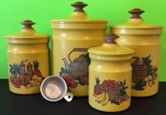 Yellow in color, with culinary designs on the front, constructed of metal. Lids are plastic with wood handles, one lid has a chip(see pictures). | eBay!