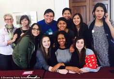 Gather round: Michelle Obama surprised a group of students from Blackfeet Nation (above) w...