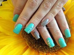 Acrylic nails with mint of spring gelish gel polish ,mink gelux gel polish ,Swarovski crystals on ring fingers