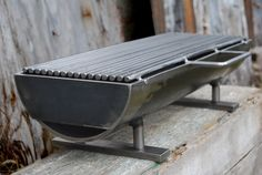 """One serious hibachi grill, known as the """"Hibachinator""""! This grill means business with a 8"""" x 24"""" removable grilling surface, and at a whopping 50 lbs. it won't blow over in a stiff breeze. With such mass, it can hold the heat, and deliver it right to the matter at hand: Grilling a meal. Made of welded steel, it is a solid grill that will outlast and outperform all competitors in its class, hands down. $842.00"""