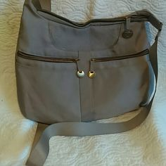 Travelon crossbody bag Very cute crossbody bag nylon material with RFID protection, excellent to travel, excellent condition in the outside but good condition in the inside ??. Travelon  Bags Crossbody Bags