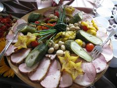 """By Pablo Chignolli: Food in America was very different from Polish food. Hoffman stated """"this is not real food: it has no taste, it smells of plastic"""" (p. 103). In the image is a Polish homemade ham and pickled vegetables platter from Traditional Poland Culinary Vacations, Inc in the U.S. Plato casero polaco de Jamón y verduras de  Traditional Poland Culinary Vacations, Inc  en los EE.UU. (Spanish). The following is a link to a Polish salad recipe: http://www.youtube.com/watch?v=FRdbS7c8H_s"""