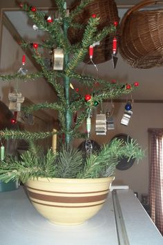 My mini tree that I made some years back with mini Kitchen ornaments on it. Love this.