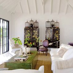 Spring style!! Mostly neutral living room WITH touches of color -- green coffee table - purple fabric on armchair and gorgeous black Chinoiserie cabinets too!!