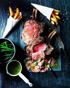 Man. Meat. Fire. Feast. Frenched & herb-encrusted. Smoked & roasted. Prime rib. Steak and taters like a boss.  Blog: http://ift.tt/1vCV6pv  Courtesy: Sainsbury Magazine | Karen Thomas  #manvswild #myfoodeatsyourfood #chef #grill #grilling #bbq #barbecue #parrilla #asado #backyardbbqhero #beef #beefitswhatsfordinner #beer #prime #meat #meatlover #carnivore #paleo #glutenfree #feast #instagood #foodstagram #foodgasm #foodpics #steak #steakporn #getinmybelly #beautifulcuisines…
