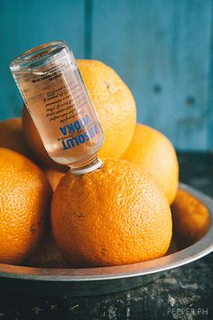 Upside Down Orange:  1 large orange 1 small bottle vodka Remove top stem part of the orange. With a knife, gently poke insides of the orange to open up the pulps. Open vodka bottle and insert into the hole. Rest orange in a small bowl, vodka bottle side up. Put in the chiller. Wait for 6-8 hours. When orange has absorbed vodka, remove bottle. Slice into wedges and enjoy. Perfect for concerts/drive in movies/football games:))