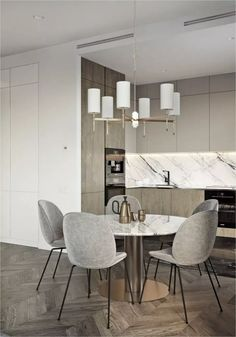 Apartment Kitchen Dark White Polished Marble Backsplash Countertop Round Dining Table Pedestal Stainless Steel Appliances Black Wire Chair Fabric Seating L Shaped Gray Wooden Cherry Cabinet To Ceiling Handleless Inspiration For Your Homes Kitchens Apartment Kitchen, Kitchen Interior, Küchen Design, Interior Design, Design Ideas, Design Styles, Cabinets To Ceiling, Round Kitchen, Diy Kitchen