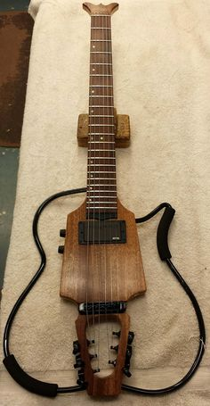 SoloEtte Jazz Travel Guitar with a Ribbon Mahogany body and a Pau Ferro fingerboard. Headless frame design jazz archtop guitar.