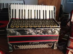 This is an Ancona Accordion. Made in Italy by Ancona a vintage company producing accordions. It is Musette tuned, and has Rhine stones for decorations. Very rare accordion that still plays.