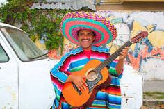Photo about Mexican funny man smiling and playing guitar with sombrero poncho in street. Image of play, instrumant, charro - 20585165 Mexican Humor, Mexican Funny, Mexican Costume, Smiling Man, Charro, Man Humor, Playing Guitar, How To Draw Hands, Royalty Free Stock Photos