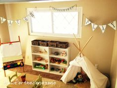 Montessori Inspired Playroom, with chalkboard table, teepee and banners