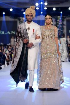 Bridal in heavily embroidered cream shirt with lehnga and groom in white sherwani with shawl latest indian and pakistani wedding matching dress combinations for bride and groom 2017