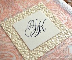 Navy and Coral Wedding Invitation with paisley wrap and pearl embossed pebble paper by Bella Carta Studio