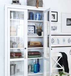 BOOKCASE :: Pretty things stored in IKEA HEMNES glass-door cabinet in white