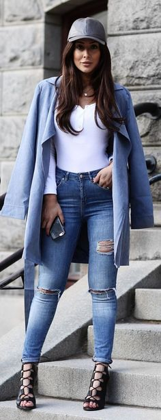 trendy street style: all blue accents wearing rips and a coat