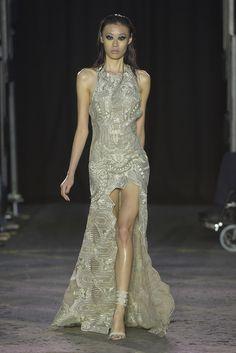 http://wwd.com/fashion-news/shows-reviews/gallery/julien-macdonald-rtw-spring-10232235/