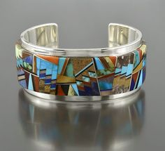 Cuff | Tommy Jackson (Navajo).  Sterling silver & Multi-Stone Inlay