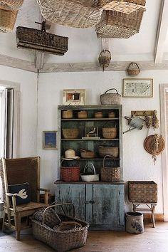 Bunny Mellon's Basket room with an Orkney chair on the left side at Oak Springs Farm in Upperville, Virginia.