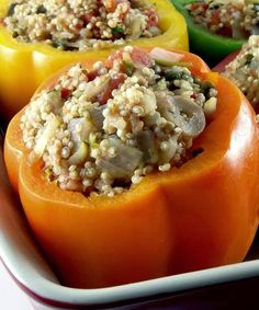 Bell Peppers Stuffed with Quinoa, Onions, Garlic, Spinach, and Tomatoes