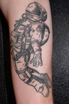 Astronaut tattoo By Toby Frey At Freys Tattoo in Eunice.