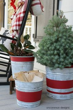Easy DIY Christmas Decor! Create beautiful Vintage Stripe Aged Galvanized Buckets via Uncommon Designs for a rustic holiday decor style.